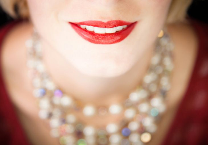 Woman with necklace smiling using dental implants - Vallejo, CA