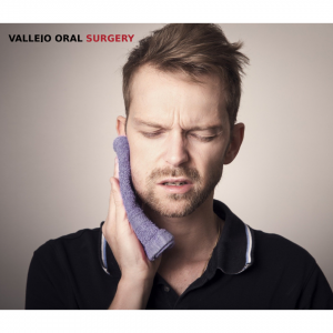 Man with facial fracture holding cheek in pain - Vallejo, CA