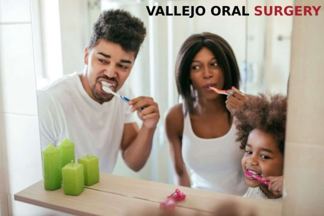 A mother and father brushing their teeth with little daughter for healthy teeth - Vallejo, CA